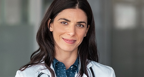 Confident female doctor smiling at camera.